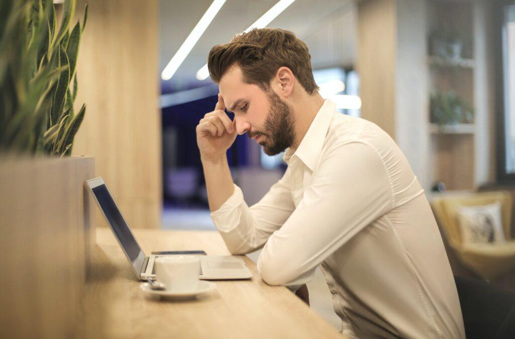 Man stressed on laptop