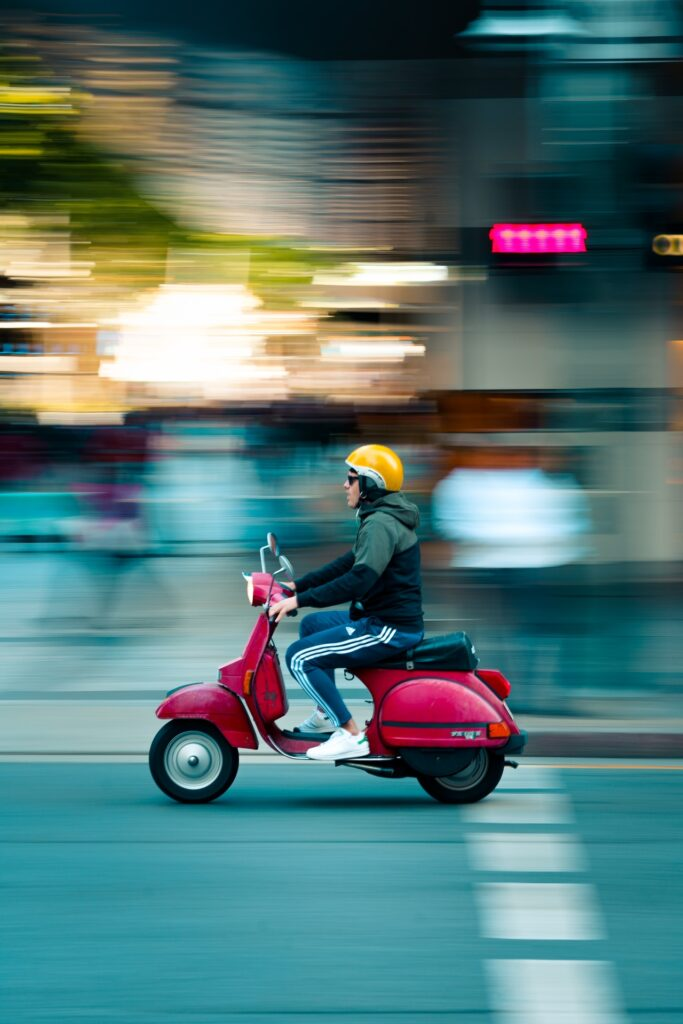 man on scooter riding fast